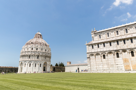 PISA, ITALY - JULY 14, 2017: Green lawn on Square of Miracles in Pisa, Italy