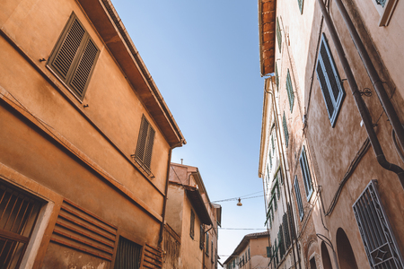 buildings on street in old city, Pisa, Italy Stock Photo