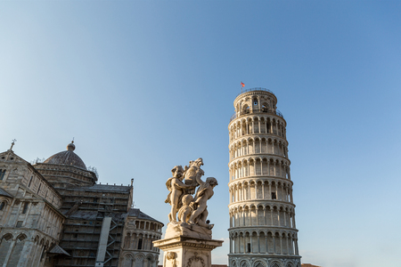 Cathedral, leaning tower and angels sculpture on Square of Miracles in Pisa, Italy