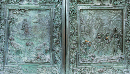 close up of ancient high relief on metal door, Pisa, Italy
