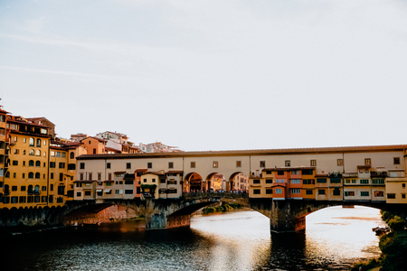 FLORENCE, ITALY - JULY 17, 2017: Famous Ponte Vecchio bridge with river Arno at sunset in Florence, Italy 報道画像