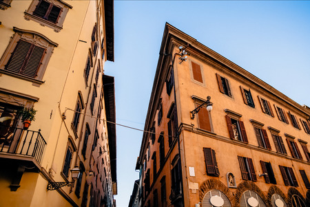cozy narrow street with beautiful historic buildings in florence, italy 写真素材