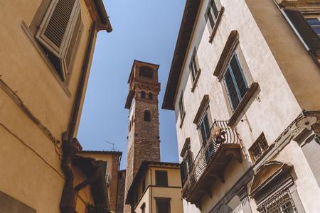 narrow street in ancient european city, Pisa, Italy