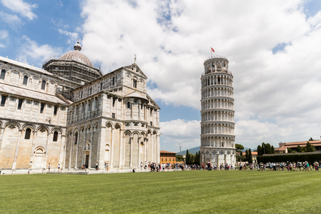 PISA, ITALY - JULY 14, 2017: travelers on Square of Miracles with leaning tower, Pisa, Italy