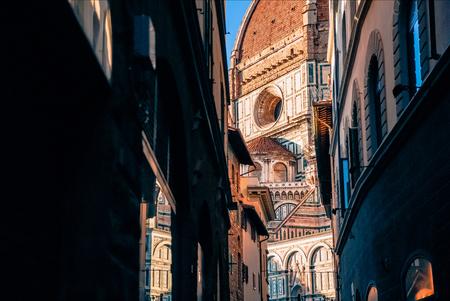 narrow street and Basilica di Santa Maria del Fiore in Florence, Italy Stock fotó