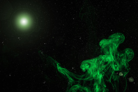 abstract background with green smoke and glowing light on black 스톡 콘텐츠
