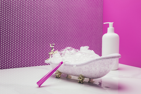 toy bath with real size shaver and lotion bottle in miniature room