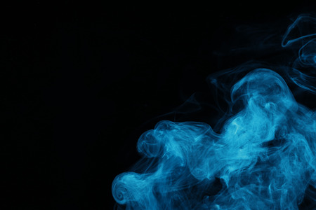 blue spiritual smoke on black background with copy space