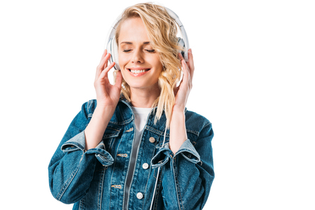 beautiful woman with closed eyes listening to music with headphones isolated on white Reklamní fotografie