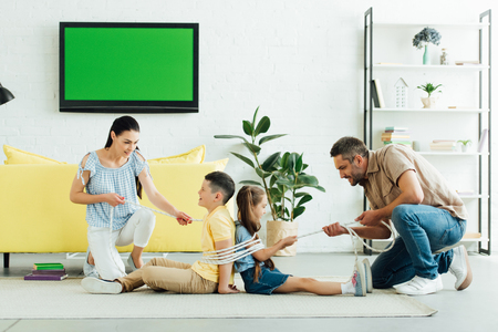 parents tying kids with rope at home