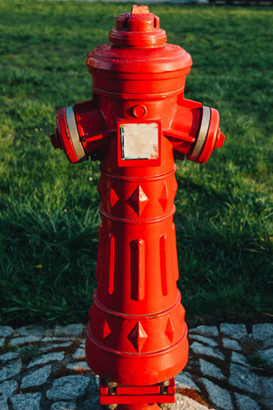 close-up shot of red antique fire hydrant on street of wroclaw