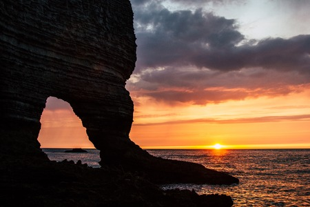 dramatic shot of rocky cliff on cloudy sunset, Etretat, France Banque d'images - 105954721