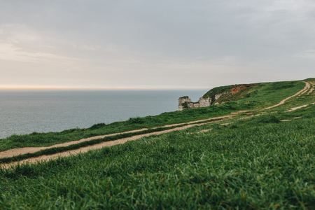 beautiful green meadow on cliff over sea at Etretat, France Stock Photo