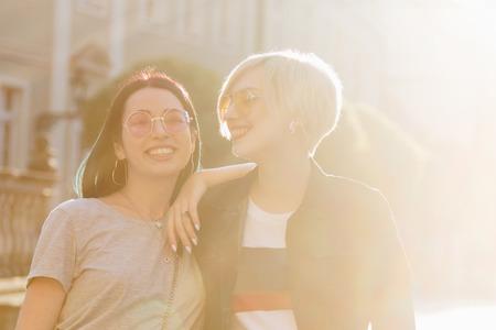 happy stylish young women in european city on sunset Zdjęcie Seryjne
