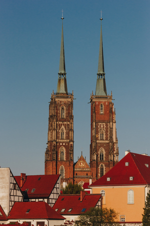 ancient Cathedral of St John Baptist in front of blue sky, Wroclaw, Poland Фото со стока