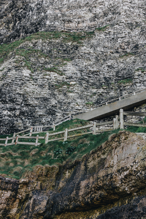 stairs with wooden railing on cliff, Etretat, Normandy, France