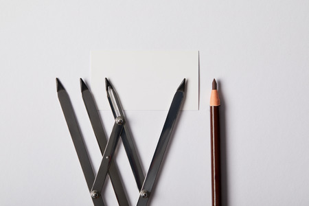 top view of tools for permanent makeup and blank card on white Stock fotó