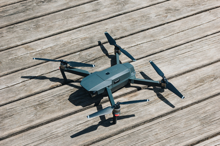 close-up view of quadcopter on wooden surface at sunny day