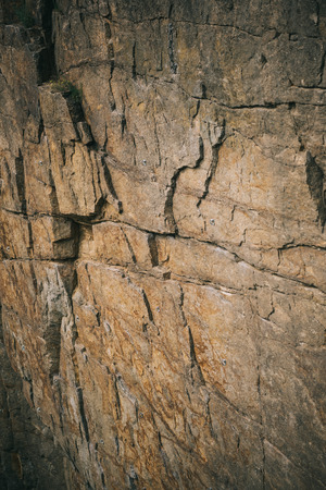 full frame image of rocky cliff surface background