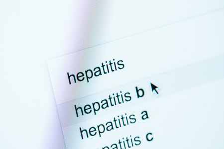 close up view of computer screen with lettering hepatitis a, b, c, world hepatitis day concept Stock Photo