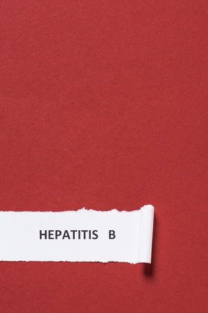 elevated view of lettering hepatitis b on paper on red background, world hepatitis day concept Stock Photo