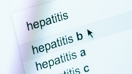 close up view of computer screen with lettering hepatitis a, b, c, world hepatitis day concept Stock fotó