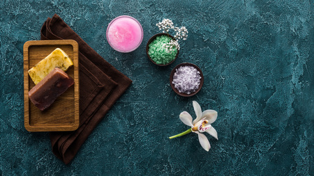 top view of beautiful orchid, handmade soaps and bath accessories Reklamní fotografie