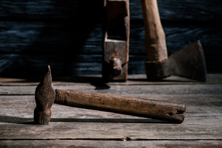 selective focus of vintage carpentry tools arranged on wooden tabletop Imagens