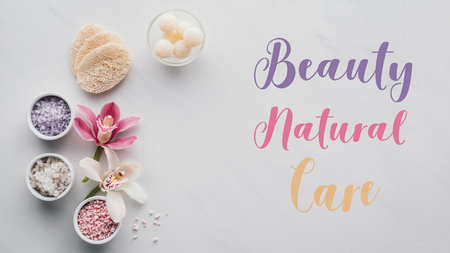 top view of spa accessories and inscription beauty natural care on white
