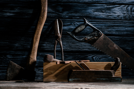 close up view of vintage carpentry tools arranged on wooden tabletop