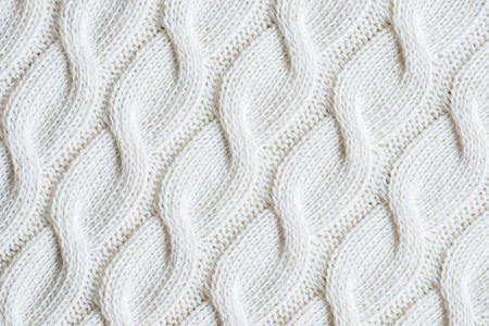 full frame image of white knitted woolen fabric background Banco de Imagens