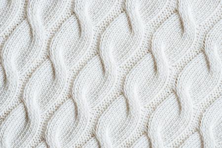 volledig beeld van witte gebreide wollen stoffenachtergrond Stockfoto