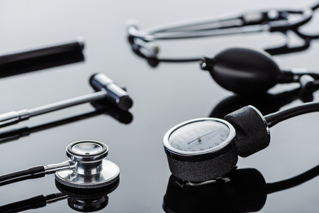 selective focus of tonometer, reflex hammer and stethoscope on glass surface