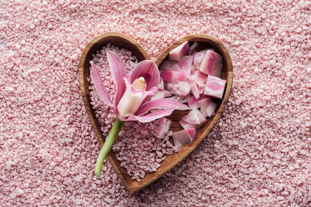 top view of pink orchid flower, heart shaped bowl, handmade soap and sea salt Stockfoto - 105957214