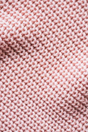full frame image of pink knitted woolen fabric background