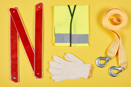 flat lay with arrangement of automotive accessories isolated on yellow Banco de Imagens - 105957552