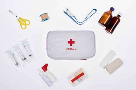 flat lay with automotive first aid kit with various medicines isolated on white Stok Fotoğraf