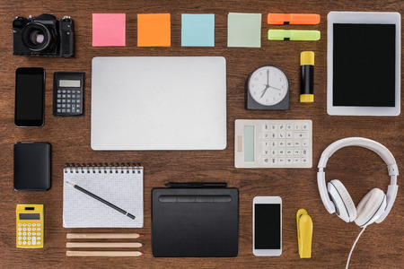 top view of arranged workplace with smartphones, laptop, digital tablet, photo camera and stationery Stok Fotoğraf