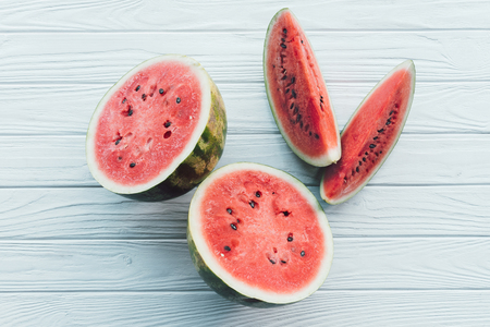 top view of juice watermelon on white wooden surface