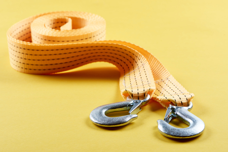 close up view of car tow rope on yellow background Stock Photo