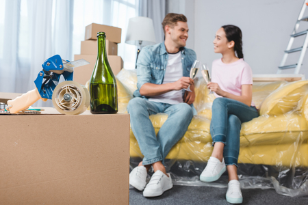 beautiful happy couple moving into new home Stock Photo