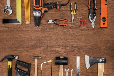 top view of arranged various tools on wooden surface Stock Photo