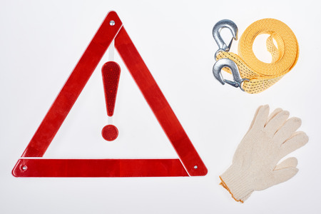 flat lay with warning triangle, gloves and car tow rope isolated on white Banco de Imagens - 105987507