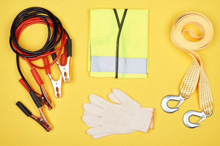 flat lay with arrangement of automotive accessories isolated on yellow