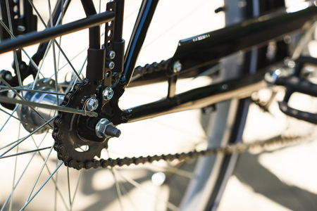 close-up view of bicycle wheel and chain, selective focus