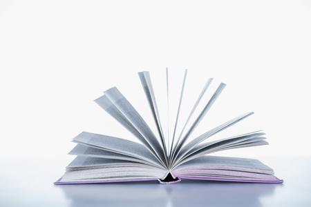 one open book on white surface Standard-Bild