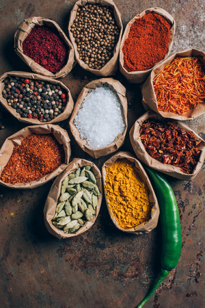 elevated view of indian spices in paper bags on table Stock Photo