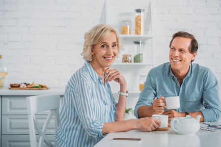 happy senior couple drinking tea together at home Stock Photo