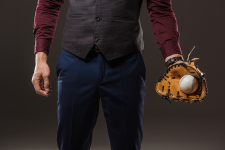 cropped hot of businessman with baseball glove holding ball isolated on black Stok Fotoğraf