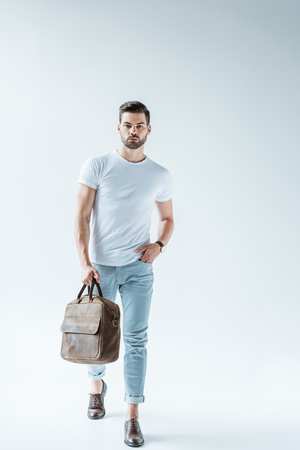 Fashionable confident man carrying briefcase on white background Stock fotó